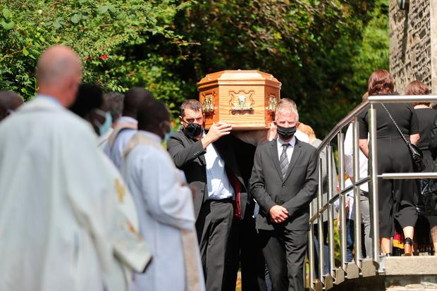 Mourners carry the coffin of Fr Con Cronin