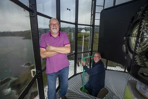 Lighthouse Technicians Malcom Gillies and Gay Mulvey at the Baily Lighthouse in Howth, Co Dublin. Photo by Mark Condren