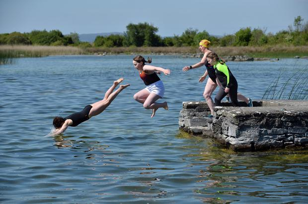 Michelle Marren, Isabel Hart, Martina Donagher and Evie Hart all from Headford take the plunge at Ballindiff Bay in County Galway as the fine weather hits the country with temperatures hitting the low 20s. Photo: Ray Ryan