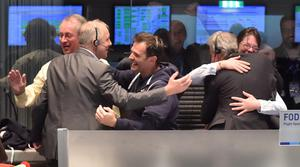 Scientists celebrate in the main control room at the ESA after the first unmanned spacecraft Philae landed on the comet called 67P/Churyumov-Gerasimenko. Photo: AP