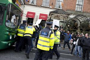 Protesters are confronted by gardai outside the Mansion House in Dublin yesterday. Photo: El Keegan