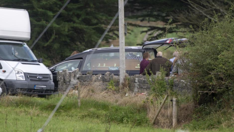 The hearse with the coffin of the late Mossie O'Sullivan from Lixnaw pictured at Kiltomey Cemetery Lixnaw today