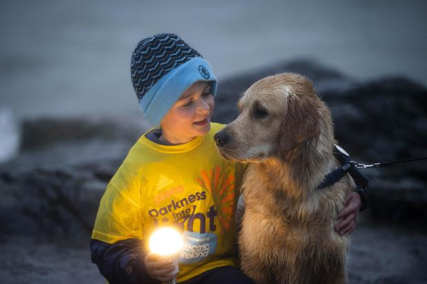 Harry Greenen (9) and his dog Rocky pictured in Greystones Co Wicklow taking part in Pieta's Darkness Into Light 2021. Picture: Andres Poveda