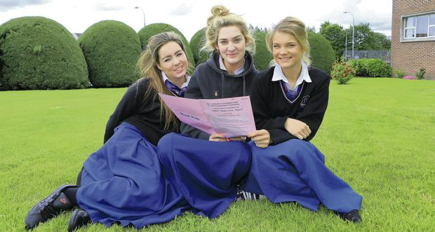 Leaving Cert students look over their English paper