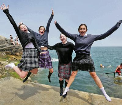 Sarah Kate Briggs, Louisa Collins, Nicola Barton and Chloe Mariotti, all from St Teresians Donnybrook, celebrated finishing their Junior Cert exams by jumping into the Forty Foot at Sandycove, Dublin, in their school uniforms. Photo: Colin Keegan, Collins