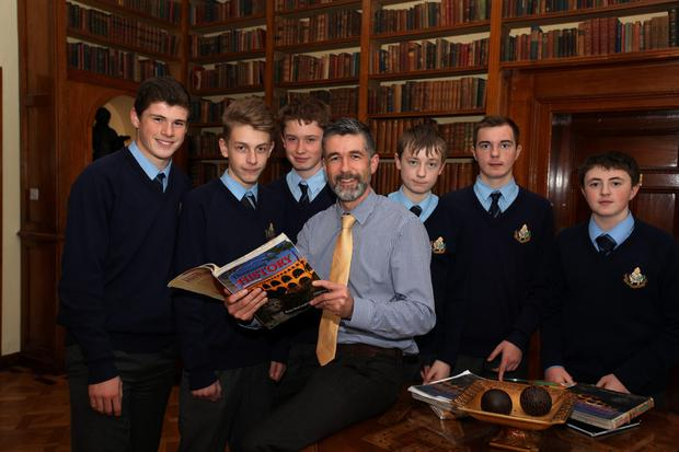 Making history: third-year students Andrew Rogers, Adam Kaiser, Cian Clancy, Tommy Troy, Daniel Waldron, and Maalchy Prenderville, with teacher Tom McGauley in the Vincentian library at Castleknock College