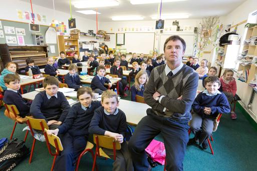Principal Brian Culloo with 37 children in Second Class at St Mochulla's National School, Tulla, Co Clare