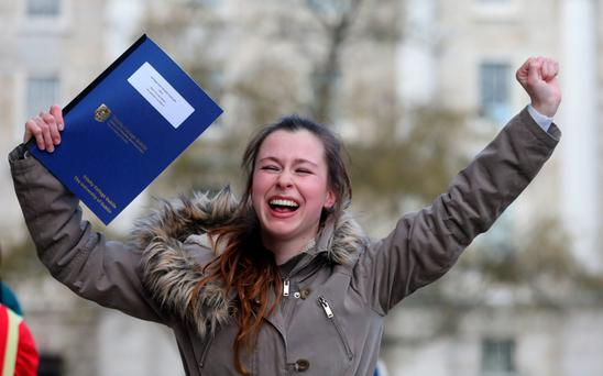 Sinead Davies celebrates after receiving scholarship in Law, during the announcement of the new Scholars and Fellows in Front Square at Trinity College, Dublin