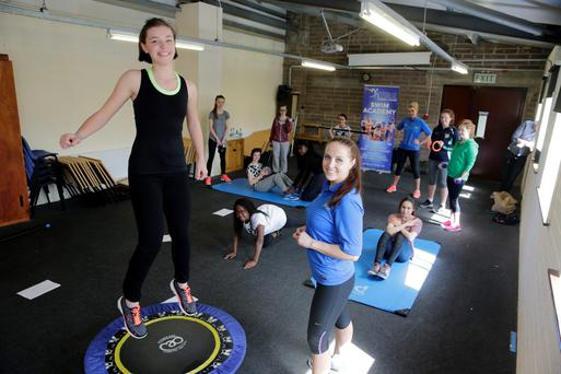 Instructor Sandra Zelnyte, Integral Fitness with student Mary Rose Porter and other Leaving cert students taking part in an exercise class during lunchtime at Our Lady's College in Greenhills, Drogheda