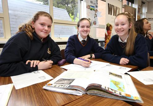 Team work: Holly Cullen, Megan Wynne and Grace McAvinue, second-year pupils at Stratford College in Rathgar, where students learn by testing each other and marking each other's work.
