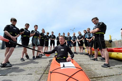 Kayaking teacher Kieran William with students from Colaiste Chorca Dhuibhne at the marina in Dingle, Co Kerry. Photo: Domnick Walsh/Eye Focus