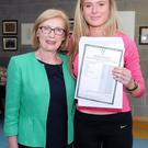 Ireland Athletics star Jenna Bromell at Castletroy College Limerick, who got seven A1's in her leaving cert is congratulated by Minister for Education and Skills Jan O' Sullivan. Photo: Gareth Williams