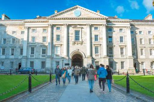 People at Trinity College yard in Dublin, Ireland