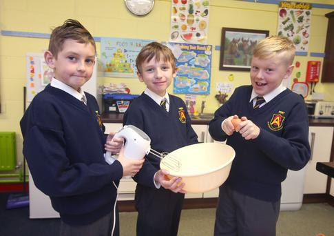 Nurturing: 10 year-olds Nathan Deans, Don Hannon, 10, and Tyler Leonard do some baking at Queen of Angels NS, Sandyford, Dublin.