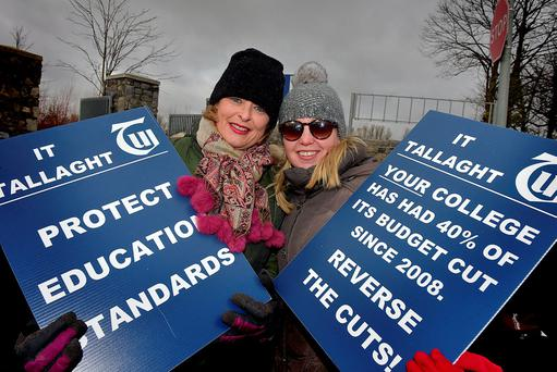 Mary Costello and Suzanne Duggan, members of the Teachers' Union of Ireland, protesting outside IT Tallaght in Dublin yesterday. Photo: Tommy Clancy