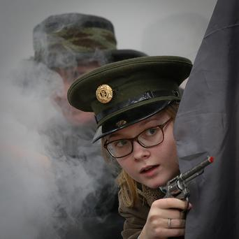 Kineshia McGettigan takes part in Coláiste Ailigh's re-enactment of the Rising in Letterkenny, Co Donegal, yesterday. Photo: Brian McDaid