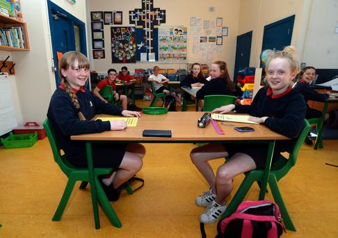 Taking the test: Sixth class pupils Katie Nic an tSaoir (12) left, from Kimmage, and Elle Coleman (12), from Terenure and their classmates at Scoil Mológa, Clareville Road, Harolds Cross, Dublin. Photo: Caroline Quinn.