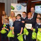 Resource teacher Sinead Herlihy, (second from left) and fourth, fifth and sixth class students from Mitchelstown CBS primary, Co Cork, are presented with their prize for winning the MindRising Games junior category at an awards ceremony in Dublin City University by DCU president Professor Brian MacCraith.