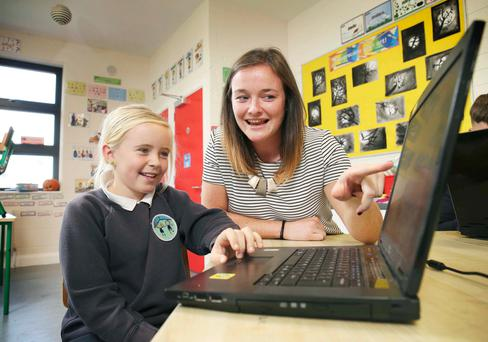 Amber O'Sullivan (10), from St Peter's primary school in Bray, Co Wicklow, with with Ciara Donnelly of Salesforce. Photo: Conor McCabe Photography