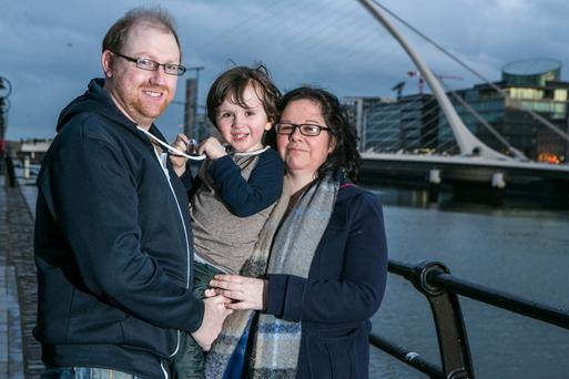 Sarah Lennon with her partner David Harrold and their son Ethan Lennon-Harrold (4). Photo: Kyran O'Brien