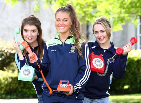 Mayo football star Sarah Rowe and DCU students Amie McGuirke and Laura Horan urge DCU alumni to donate to the Access Scholarships during the telethon. Photo: Marc O'Sullivan