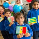 Flag day: Rama Shaban (at back) and Diaa, Ajnana and Sheffa Zlhnah, all from Syria, at Scoil Ghobnatan Bellevue, Mallow, Co Cork Photo: Michael Mac Sweeney/Provision