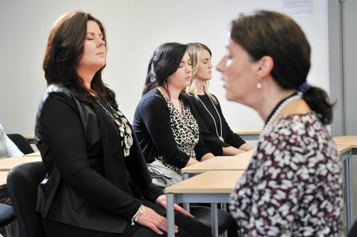 Wellbeing coordinator Maura O'Neill gives a lunchtime mindfulness class at Brookfield Health Sciences Complex in UCC. Photo: Daragh McSweeney/Provision