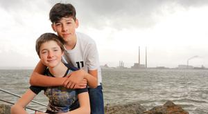 Alex Burtenshaw (left) and Michael Finn pictured at home in Dublin last week before returning to school on Inis Oirr. Photo: Gerry Mooney