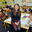 Principal of Tuam Educate Together Nuala Bourke pictured with her junior infants class. Photo: Ray Ryan