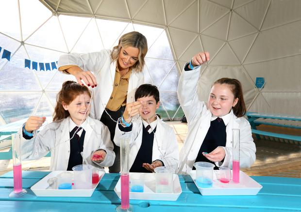 Michelle Maher with Caoimhe Byrne (10), Tim Swan (11) and Ella Mulvey (10) from St Patrick's National School during their visit to the Cool Planet Experience at Powerscourt Estate. Photo: Frank McGrath