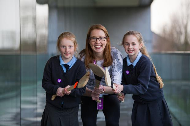 Rena Buckley with Aoibhinn O Connor and Caitlynne Ryan McNamara from Herbertstown NS, Co Limerick, at this year's RDS Primary Science Fair Photo: Oisin McHugh/True Media