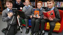 Luke Mc Donagh (12) on camera , 6th Class Teacher Kevin Munnelly, James Crowley (12), Aaron Caulfield (12) and Callum O'Reilly (12) from the Star of the Sea National School in Sandymount filming book reviews as part of the (FIS) Film In Schools Book Club