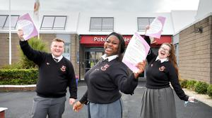Vicky Ogundipe (centre), Karl Fitzpatrick and Molly McFarland, of Pobalscoil Neasáin in Baldoyle, Dublin, celebrate finishing English paper one. Photo: Frank McGrath