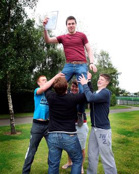 Conor Gallagher, a student at St Michael's College in Dublin being lifted high by fellow students. Photo: Tom Burke