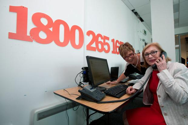 Education Minister Jan O'Sullivan with Mai Kerins, vice-president of the Institute of Guidance Counsellors, at the helpline offices in Santry, Dublin, yesterday
