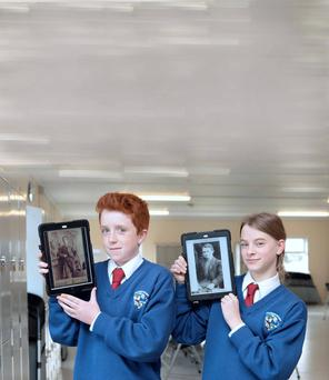 De Lacy College, Ashbourne, Co Meath 1st year students Eoin Lawless, 13, with a photo of his great-great grandfather Edward Lawless, a 1916 Volunteer who fought in the 1916 Battle of Ashbourne, and Katie Colbert, 13, with a photo of her great-granduncle Irish Volunteer and IRB member who fought in Dublin in 1916; Con Colbert.