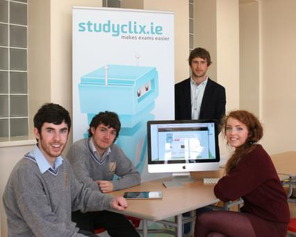 Luke Saunders (back), founder of Studyclix, helps students study for the Leaving Cert.