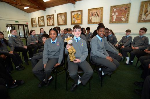 Darragh Gaskin, 13, from Johnstown, holding Sophie the giraffe during circle time with fellow first year students from St Mark's Community School, Tallaght, Dublin. Photo: Caroline Quinn