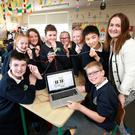 Principal Ciara Brennan with 6th class students Stephen Mooney, Hannah Cowap, Hannah O'Brien, Jack Barsoum, Alana Murphy Porter, Amy Doonan, Jack Jin and Alex Coffey at St Peter's Primary School, Bray, with their Makey Makey Board, which turns them into a ­human piano. Photo: Frank McGrath.