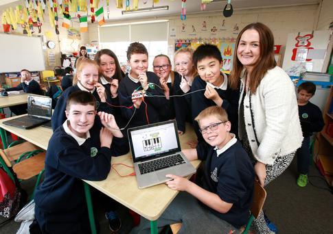 Teacher Ciara Brennan with 6th class students Stephen Mooney, Hannah Cowap, Hannah O'Brien, Jack Barsoum, Alana Murphy Porter, Amy Doonan, Jack Jin and Alex Coffey at St Peter's Primary School, Bray, with their Makey Makey Board, which turns them into a ­human piano. Photo: Frank McGrath.