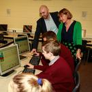 Leslie Turner, SchoolWise CEO, and co-founder, Sally Roynane, ICT coordinator with students from Presentation De La Salle, Carlow, viewing the new online platform