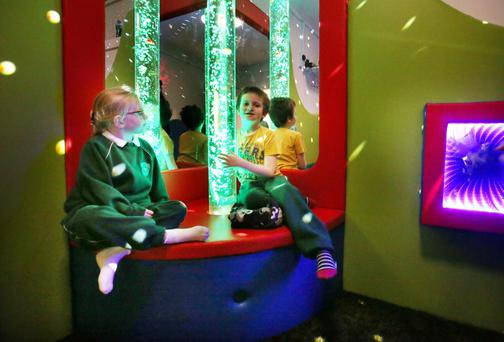 Lucy Hanlon and Matthew McCartie in the sensory room at Holy Family NS Monkstown Farm, Dun Laoghaire. Photo: Tony Gavin