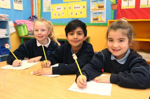 All the write moves: Georgia Hughes (7), Sonny Abbasi (9) and Kiera Blakemore (7), second class pupils at St Raphael's National School in Ballyfermot, practise their handwriting. Photo: Damien Eagers