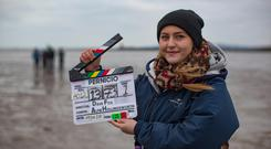 And action: Sarah Dillon, gaffer, shooting on location with her fellow students from IADT Dun Laoghaire. Photo: Arthur Carron