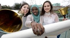 Previous ActionAid Speech Writing Competition winners Helen Ryan, Sooad Saleh and Emma Young at an event to encourage students to enter the 2018 contest