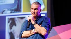 A member of the gardai speaks at the event