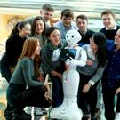 UCD students gather around Pepper the robot, which is preparing them for a future where humans and robots work together