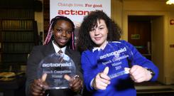 Kirsten Soney-Ituen from Gaelcholáiste Cheatharlach and Clodagh Boyce from St Joseph's Mercy Secondary School with their ActionAid Speech Writing Competition 2019 awards. Photo: Eoin O'Neill
