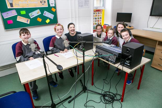 Pupils Jason Grant (8), Kacie May Moloney (8), Grace Campbell (7) and Liam Nolan (8) with Creative Associate Anne Cradden, Principal Siobhan Whelan and Creative School Coordinator Katie Adderley creating their podcast in St Peter and Paul Primary School, Balbriggan. Photo: Kyran O'Brien