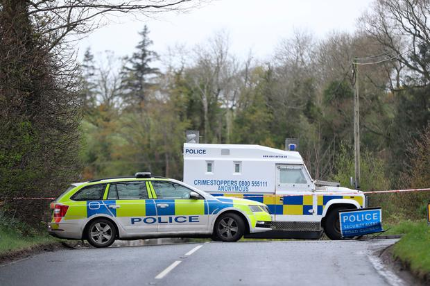 PSNI vehicles block a road near the home of the officer